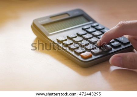 Close up of hands with calculator counting money and making notes at home,savings, finances, economy and home concept,copy space.