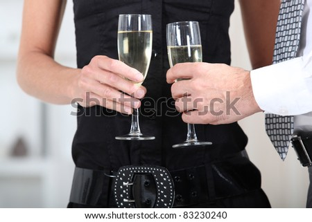 close-up of hands with glasses - stock photo