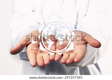 Close up of hands with white Earth planet figure