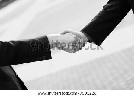 close up of handshake between two businessmen - stock photo