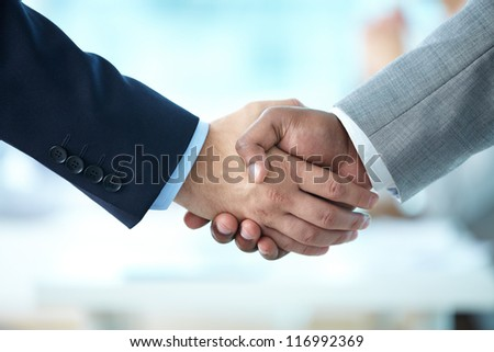 Close-up of handshake of business partners - stock photo