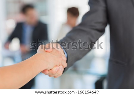 Close-up of handshake to seal a deal after a business meeting