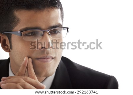 Close-up of handsome businessman contemplating over white background