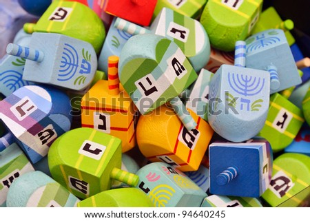 close up of hanukkah dreidels on market stand - stock photo