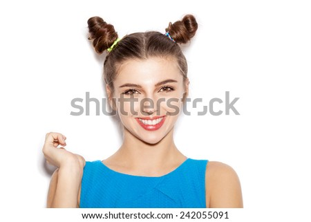 Close-up of Happy Brunette Woman laughing. Beauty girl with bright make-up hairstyle with horns in a blue dress smiling. White background, not isolated - stock photo
