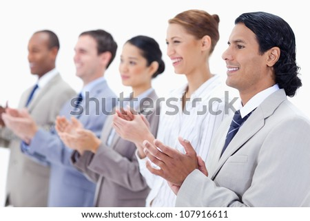 Close-up of  happy business people applauding against white background - stock photo