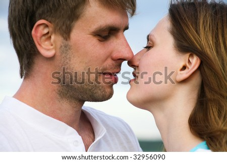 Close-up of happy couple kissing each other - stock photo