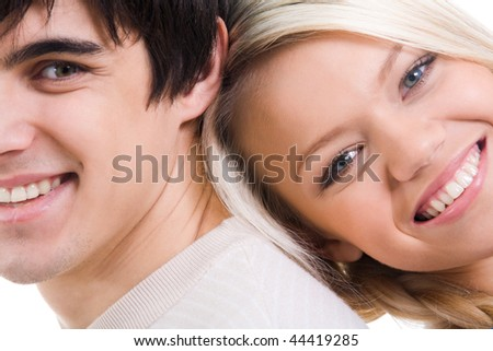 Close-up of happy couple looking at camera with smiles - stock photo