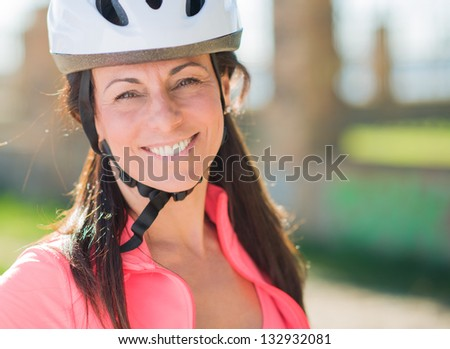 Close-up Of Happy Cyclist Woman, Outdoors - stock photo