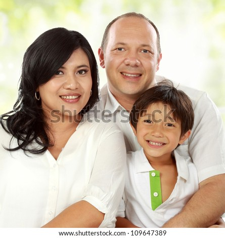 close up of Happy family portrait smiling - stock photo