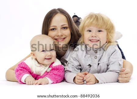 Close-up of happy mother with her children - stock photo