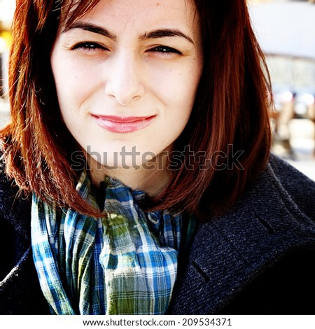 Close-up of  happy woman's face. - stock photo