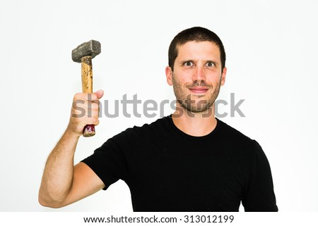 close-up of happy young caucasian man ready to repair something with an hammer - isolated on white background - stock photo