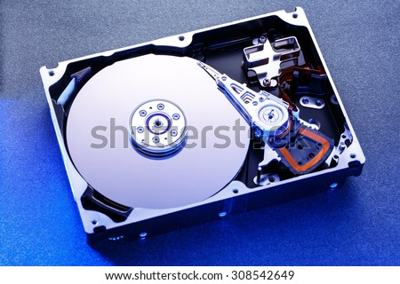 Close up of hard disk's internal mechanism hardware - stock photo