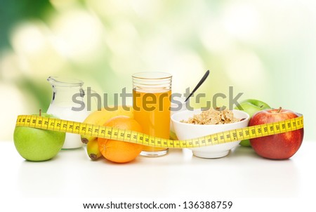 close up of healthy breakfast and measuring tape - stock photo