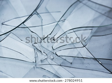 Close up of heap of shattered transparent glass - stock photo