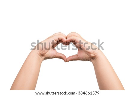 Close up of heart made by children hands isolated on white background - stock photo