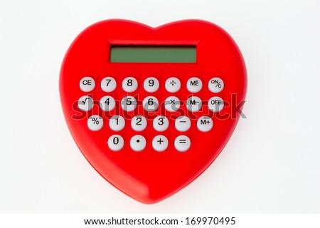 Close-up of heart-shaped red calculator. - stock photo
