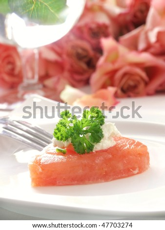 close-up of heart shaped smoked salmon appetizer with cream cheese and parsley