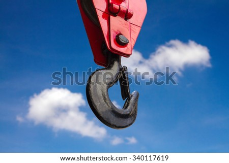 Close up of heavy-duty steel hook on blue sky background - stock photo