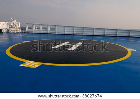 Close up of helipad area on-board ship - stock photo