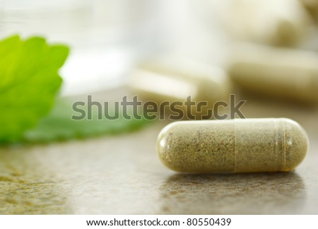 Close up of herbal medicine in capsules - stock photo