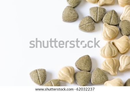 Close-up of herbal supplement pills - stock photo