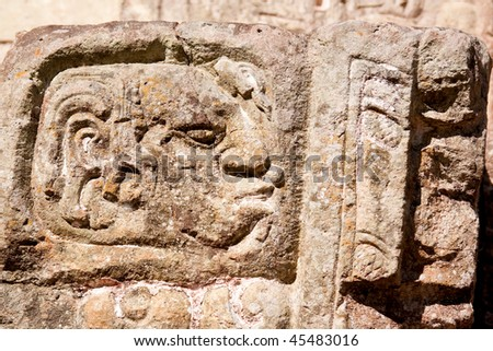 Close up of hieroglyph carved into rock at the ancient Mayan ruins of Copan. Honduras, Central America. - stock photo