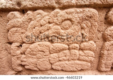 Close up of hieroglyph on Altar H at the ancient Mayan city of Copan. Honduras, Central America. - stock photo