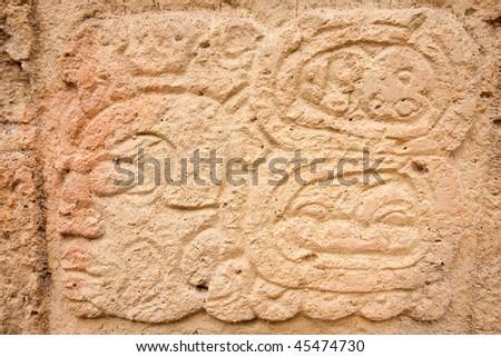 Close up of hieroglyph on Stela 2 at the ancient Mayan ruins of Copan. Honduras, Central America. - stock photo