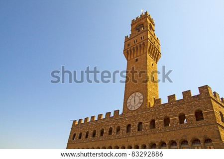 Close up of high part of Palazzo Vecchio, the great Palace at center of Florence, Italy - stock photo