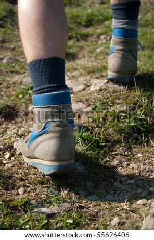 Close-up of hiking shoes in nature - stock photo