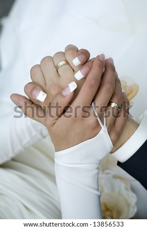 close up of holding hands bride and groom - stock photo