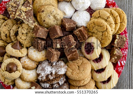 Close up of holiday baked good tray filled with homemade cookies and candies