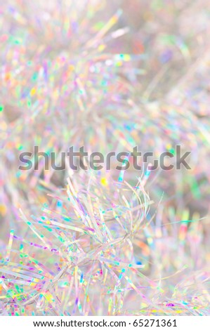 Close-up of holographic Christmas tinsel as background. - stock photo