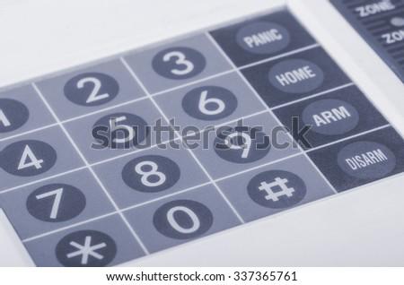 Close up of home alarm system keypad - stock photo
