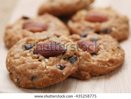 Close up of Homemade Almond cookies on wooden table background.