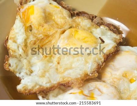 close-up of homemade fried eggs - stock photo