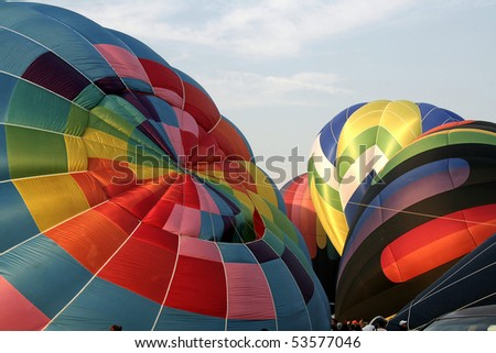 close up of hot air balloons as they are being inflated - stock photo