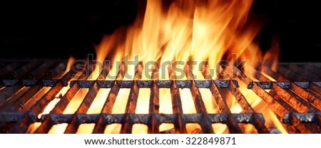 Close-up Of Hot BBQ Flaming Grill With Bright Flames And Glowing Coals - stock photo
