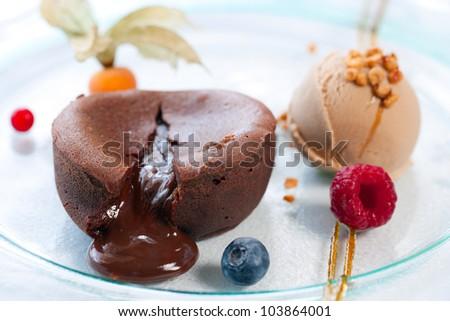 Close up of hot melting chocolate cake dessert. - stock photo