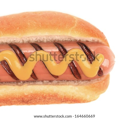 Close up of hotdog with mustard. Whole background.