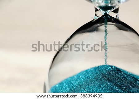 close up of hourglass clock - stock photo