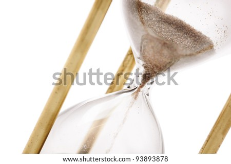 Close up of hourglass isolated on white background, selective focus - stock photo