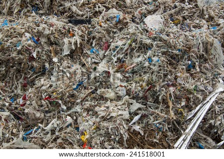 Close up of huge pile of shredded municipal waste - stock photo