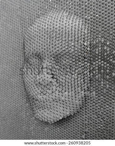 close up of human face concept made from pin board toy - stock photo