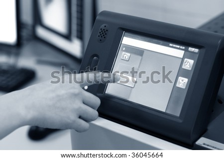 close-up of human finger touching computer keys - stock photo