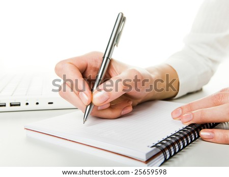 Close-up of human hand before writing down business plan on page of notepad - stock photo
