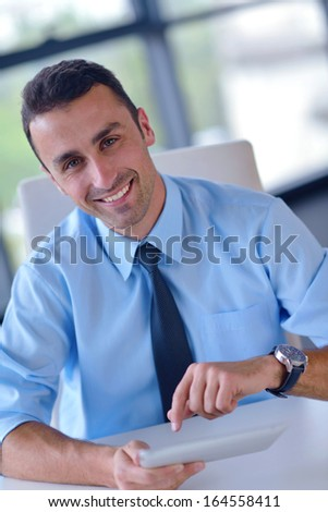 close-up of human hand  business man using tablet compuer at office - stock photo