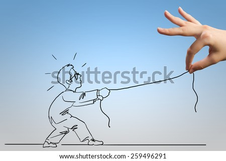 Close up of human hand catching businessman